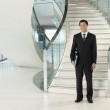 Confident Businessman in front of stairs — Stock Photo #33849527