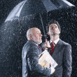 Businessmen Under Umbrella — Stockfoto