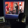 Band in recording studio — Stockfoto