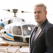 Businessman waiting at helicopter pad — Stock Photo