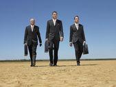 Three businessmen  walking — Stock Photo