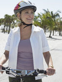 Woman on bicycle on tropical beach — Stock Photo