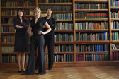 Lawyers in library standing — Stock Photo