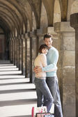 Couple embracing under archway — Stock Photo