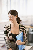 Office worker holding files — Stock Photo