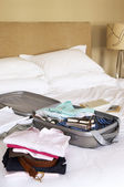 Packed Suitcase on Bed — Stock Photo