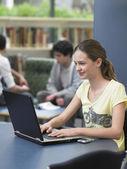 Teenage girl using laptop — Stock Photo