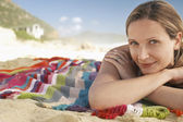 Woman lying on beach — Stock Photo