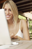 Woman using laptop — Stock Photo