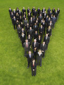 Business people standing in triangle formation — Foto Stock