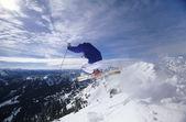 Skier jumping on mountain — Stock Photo
