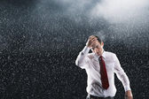 Businessman running hands through wet hair — Stock Photo