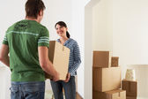 Couple Moving into New Home carrying box — Stock Photo