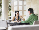 Couple laughing at restaurant — Stock Photo