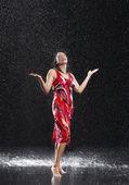 Woman arms raised in rain — Stock Photo