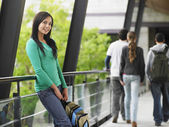 Teenage girl leaning against railing — Stock Photo