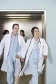 Doctors running out of elevator — Stock Photo
