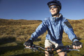 Woman sitting on bicycle — Stock Photo