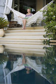 Woman sitting on hammock — Stock Photo