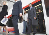 Commuters Getting on Train — Stock Photo