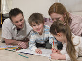 Parents on Floor Coloring — Stock Photo