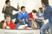 Friends watching TV and celebrating — Stock Photo