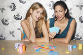 Girls playing cards — Stock Photo