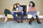 Third wheel sitting arms crossed — Stock Photo