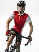 Bicyclist riding bicycle — Stockfoto