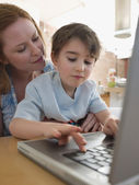 Mother Helping Son — Stock Photo