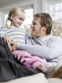 Daughter in Father's Lap — Stock Photo