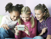 Girls playing with  gadget — Stock Photo