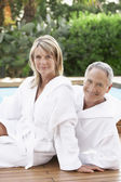 Couple in bath robes — Stock Photo