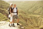 Hiking couple on top of mountain — Stock Photo