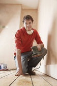 Man Renovating Room — Stock Photo