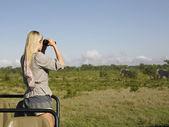 Woman on safari — Stock Photo