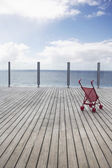 Baby stroller on wooden Dock — Stock Photo