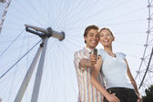 Vacationing Couple Photographing Themselves — Stock Photo