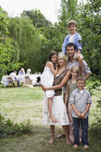 Couple and four kids in garden — Stock Photo