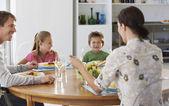 Family eating dinner — Stock Photo