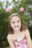 Girl with Floral Deely Boppers — Stock Photo