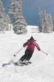 Young woman skiing down — Stock Photo