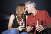 Couple with champagne flutes rubbing noses — Stock Photo