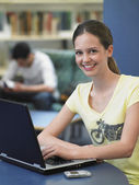 Teenage girl using laptop — Stock Photo