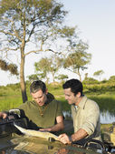 Men reading map — Stock Photo