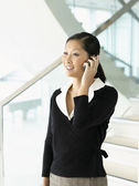 Smiling businesswoman talking on mobile — Stock Photo