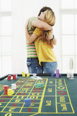 Man hugging woman at roulette table — Stock Photo