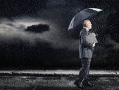 Businessman Walking in rain — Stock Photo