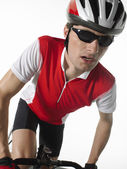 Bicyclist riding bicycle — Stock Photo