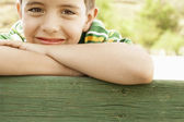 Boy leaning on railing — Stock Photo
